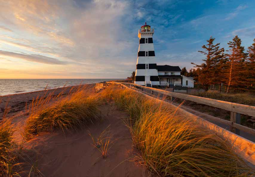 Photo: John Sylvester Photography West Point Lighthouse Museum and Inn (1875) is situated along P.E.I. s scenic North Cape Coastal Drive in Cedar Dunes Provincial Park.