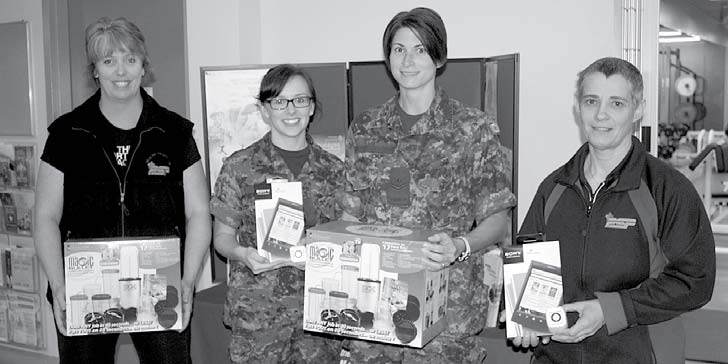Page 7 Ju 22, 2013 Healthy haul Health Promotion manager Lisa White, left, and assistant Edith Trombley, right, helped with the loot recent won by three 14 Wing personnel in the May Canadian Armed