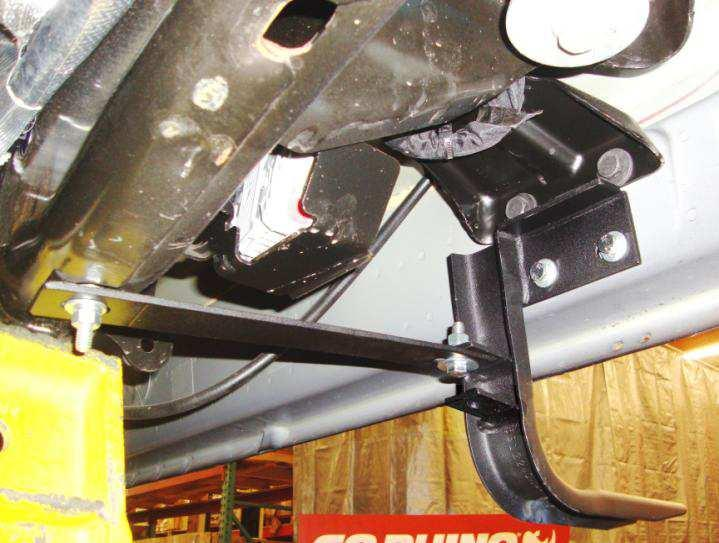 Locate the obround hole in the bottom of the frame rail (Photo 6) and install one 5/16 T-Bolt in the hole.