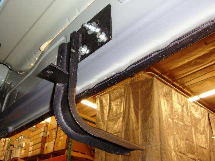 If the vehicle has hexagon holes in the rocker panel at the center and rear of the cab, remove the tape covering the obround hole in the rocker panel, and install (1) 3/ T-Plate in the rocker panel